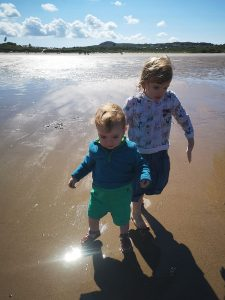 siblings loving beach life not just a tit camping with kids