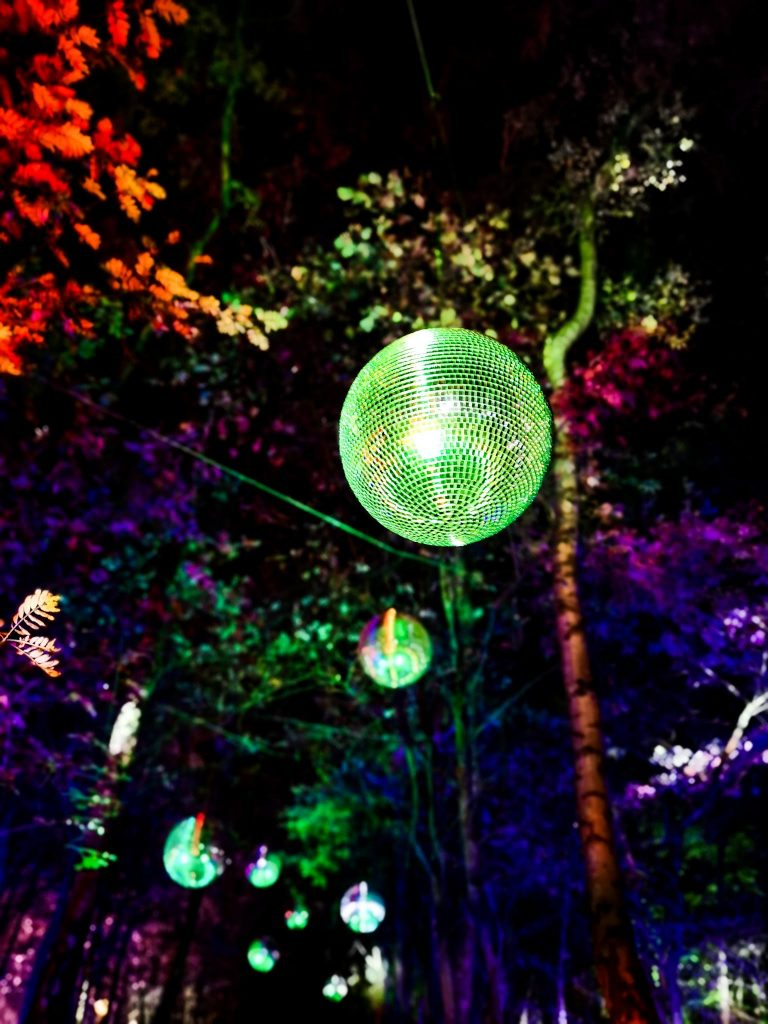 not just a tit magical woodland experience green disco balls in trees