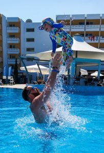 summer holiday corfu not just a tit lifestyle blog swimming pool throwing in air